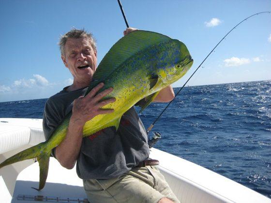 angler-holding-dolphin-fish-mahimahi-560x420